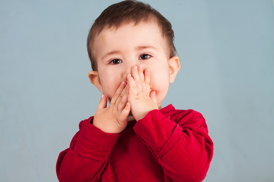 bigstock Child Covers Mouth With Hands 55173149