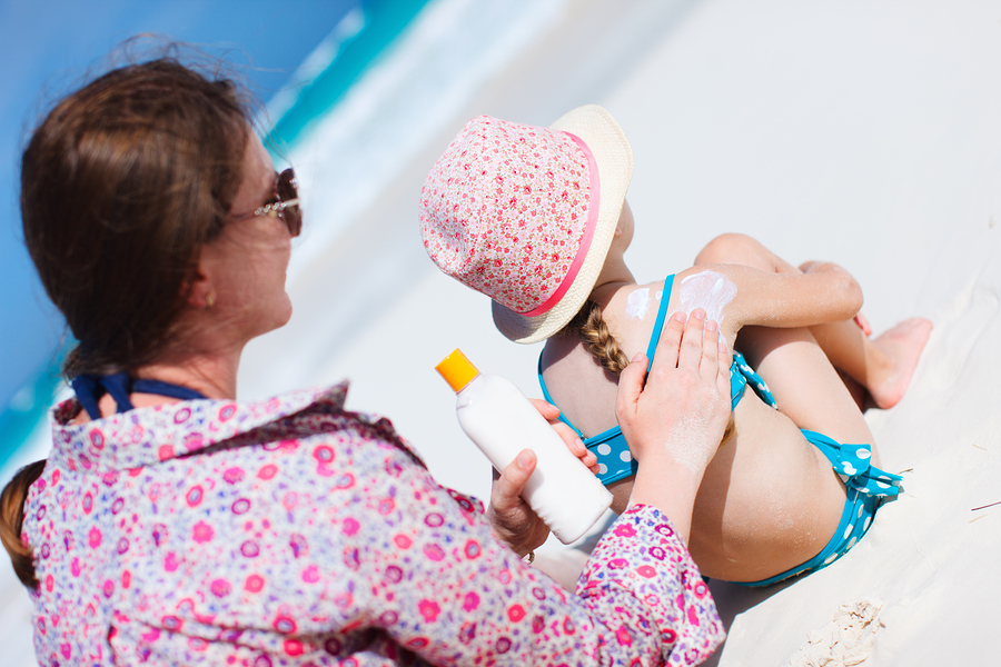 bigstock Mother applying sunblock cream 71087044